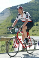 Danial Guise on Alp D'Huez on his course frame